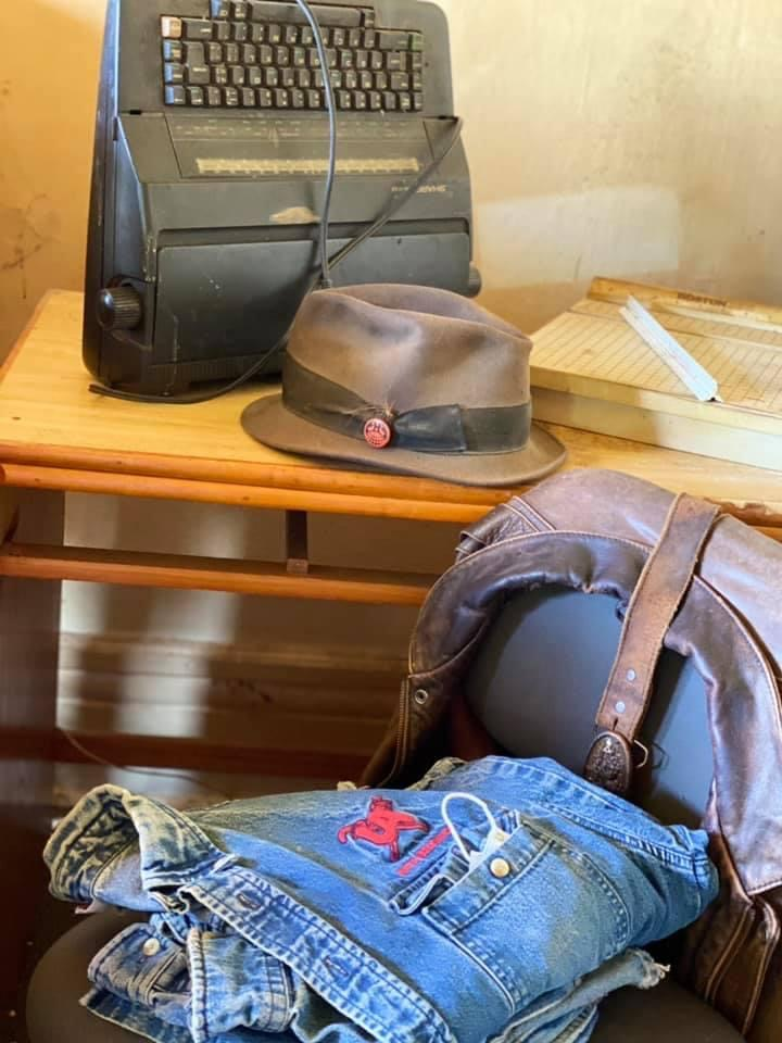 Image shows Miller's iconic typewriter, hat, and other personal effects.